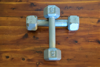 Dumbell weights in the form of a cross representative of spiritual exercise for Christ and our soul