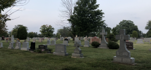 photo depicts a cemetery in association with death and the resurrection